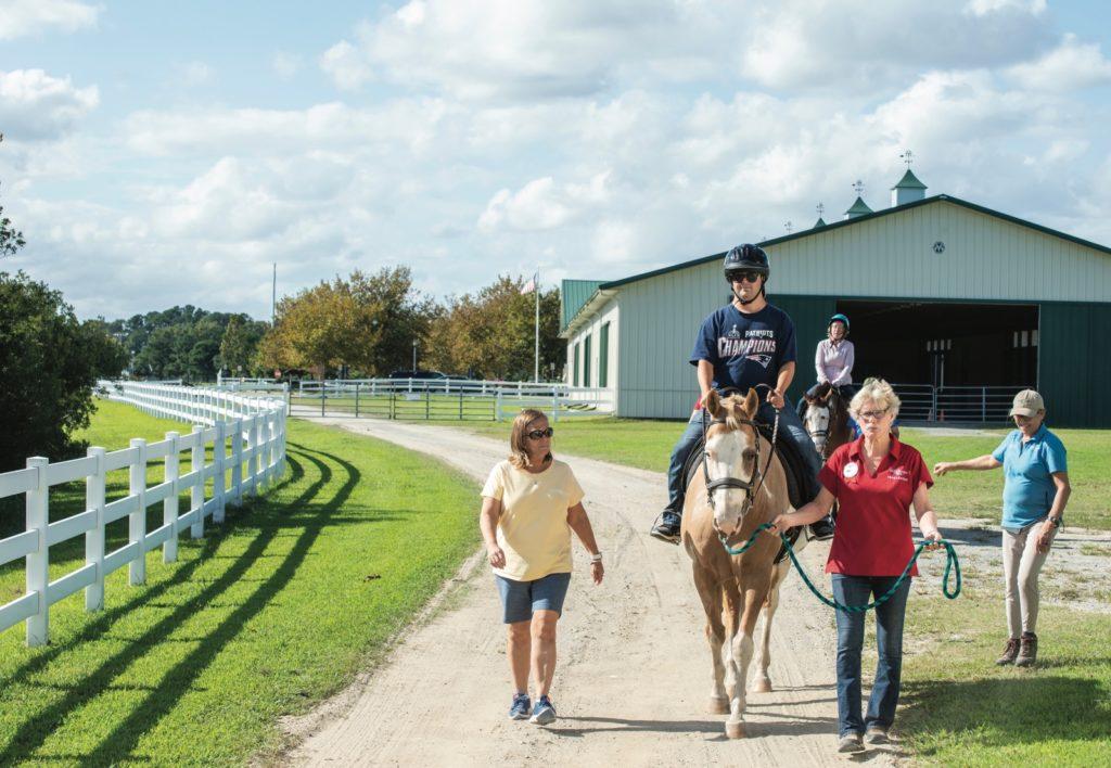 Philip progresses in EQUI-KIDS' therapeutic riding program